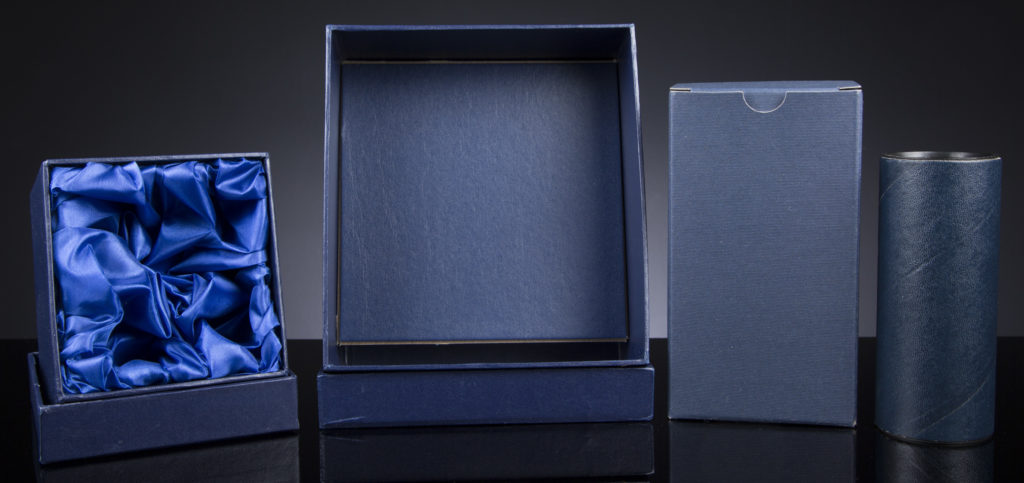 The Glass Scribe offer a wide range of packaging options. Pictured are examples of a Satin Lined Box, Rigid Box, Die-Cut Box and a Tube